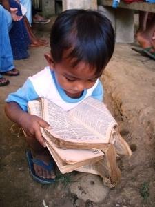 Child reading Bible